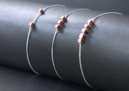Drei Flechtarmbänder von Faunuge weiß und roségold