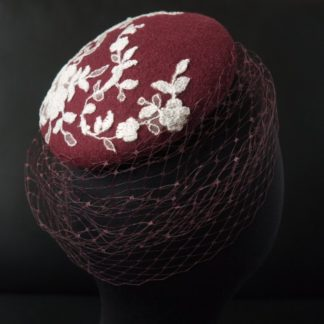 a burgundy fascinator of Faunauge