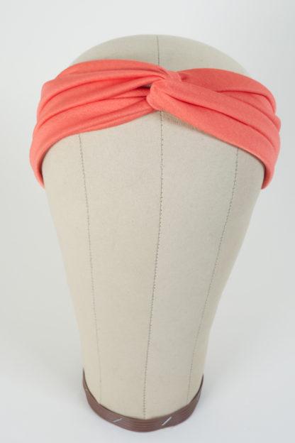 Stirnband Pfirsichfarben aus glatt glänzendem Polyester Vorderansicht