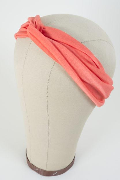 Stirnband Pfirsichfarben aus glatt glänzendem Polyester Seitenansicht links