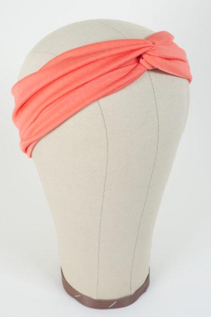 Stirnband Pfirsichfarben aus glatt glänzendem Polyester Seitenansicht rechts