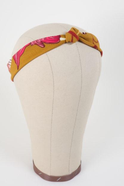 Schmales Stirnband mit einem Knoten in Senfgelb mit Blumen