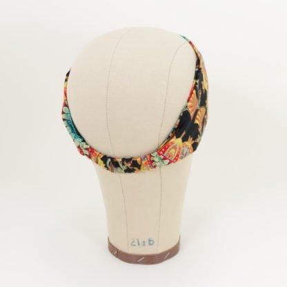 Stirnband Inge mit buntem und goldenem Muster hintere Ansicht mit Gummizug