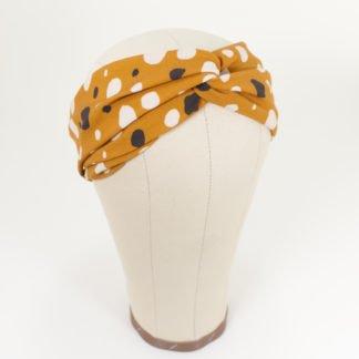 Stirnband Lisa in ockerfarbiger Viskose mit schwarzweißen Punkten